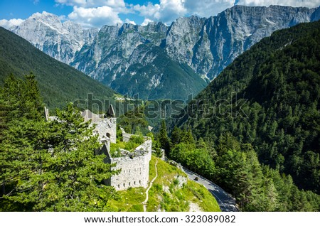 Large view on the old destroyed house in mountains - stock photo