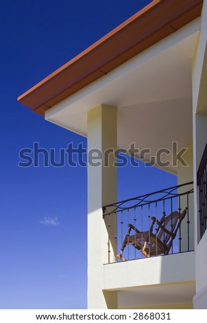 Large villa with a balcony for enjoying warm, tropical weather - stock photo