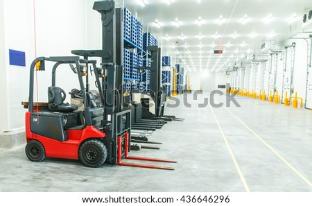 Large warehouse with forklifts - stock photo