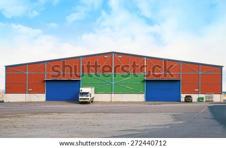 Large warehouse with two sliding gates. - stock photo