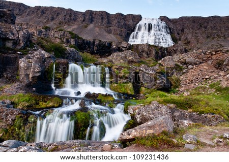 large waterfall with cascades, long exposure time - stock photo