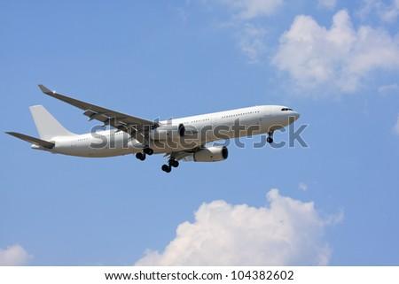 Large white jet aircraft landing - stock photo