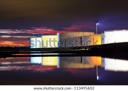 large white tanks for petrol and oil in the twilight time - stock photo