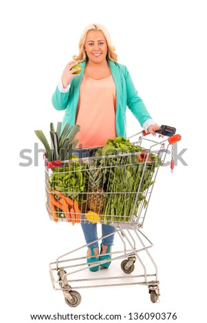 Large woman at the supermarket in search for healthy food - diet concept - stock photo