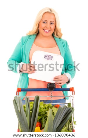 Large woman at the supermarket in search for healthy food - diet concept
