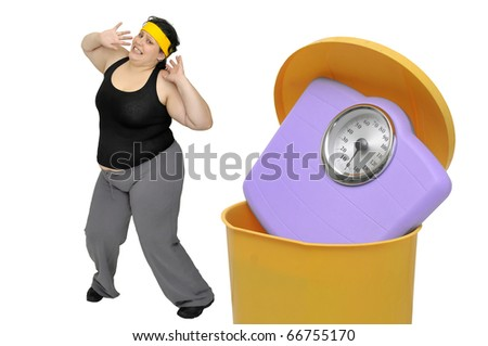Large woman looking at a weight scale in the garbage - stock photo