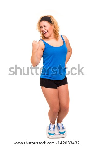 Large woman very happy with the results of her new diet - stock photo