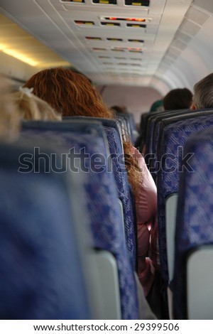 Large women squeezed in plane seat