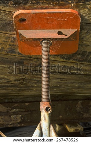 Large wood boat sits at dry dock awaiting repair in southern Oregon, detail of support stand - stock photo