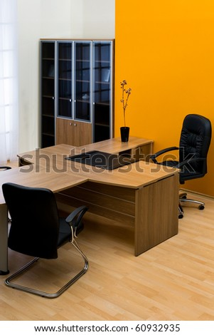 large wooden desk in a modern office - stock photo