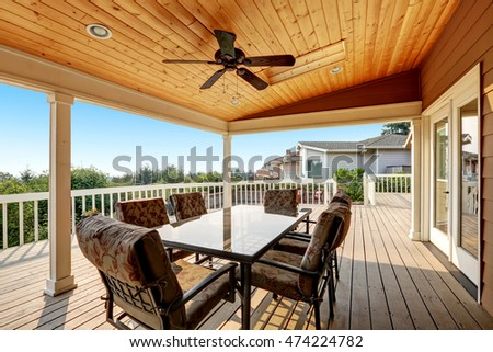 Exceptional Large Wooden Walkout Deck With Flat Roof Extension And Comfortable Seating  Arrangement. Northwest, USA