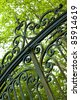 Large wrought iron gate at the entrance of a property in the countryside - stock photo