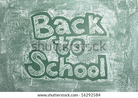 large XXL image of an old chalkboard with Back to school written on it - stock photo
