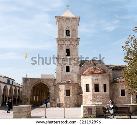LARNACA, CYPRUS - FEBRUARY 7: Famous orthodox Christian church of saint Lazarous with people around on February 7, 2015 in  Larnaca town, Cyprus. - stock photo