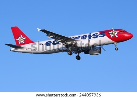 LARNACA, CYPRUS - MAY 17, 2014: Edelweiss Air Airbus A320 lands in Larnaca International Airport. Edelweiss is part of Lufthansa Group. Lufthansa Group employs 118,214 people. - stock photo