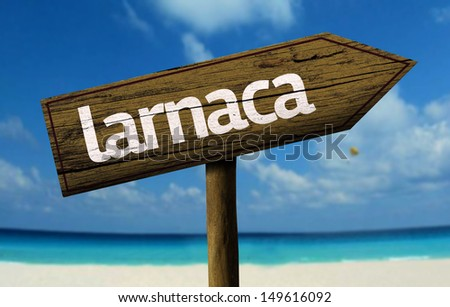 Larnaca wooden sign with a beach on background - stock photo