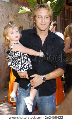 Larry Birkhead and daughter Dannielynn attend the Simpsons Ride Opening Celebration Party held at the Universal Studios Hollywood in Universal City, California, United States on May 17, 2008. - stock photo