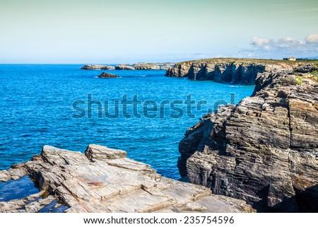 Las Catedrales beach in Galicia, Spain. Paradise beach in Ribadeo, Spain - stock photo
