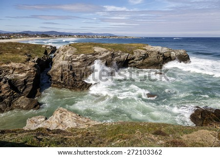 Las Catedrales beach in Galicia, Spain. Paradise beach in Ribadeo, Spain In the background Foz - stock photo