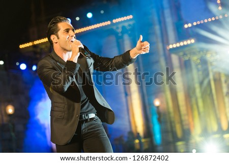 LAS PALMAS, SPAIN - FEBRUARY 1: Singer David Bustamante from Spain, performs onstage during the carnival Queens Gala on February 1, 2013 in Las Palmas, Spain. - stock photo
