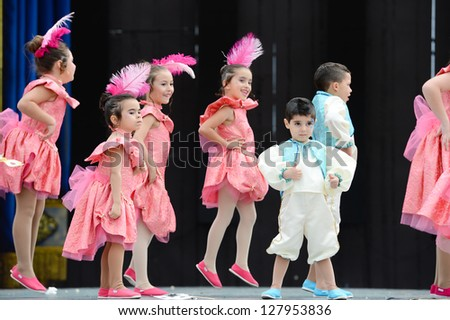 LAS PALMAS, SPAIN -FEBRUARY 10:Unidentified children from dance group Ceip Los Tarahales, from Canary Islands, performing during Children's Costume and Murgas, on February 10, 2013 in Las Palmas,Spain - stock photo