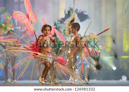 LAS PALMAS, SPAIN - FEBRUARY 2: Unidentified children from dance-group Samba Latina, from Canary Islands, performs onstage during Children's dance contest on Saturday 2, 2013 in Las Palmas, Spain. - stock photo