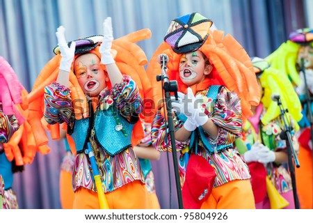 LAS PALMAS ,SPAIN - FEBRUARY 19: Unidentified kids from Los Baby Chancletas, from Canary Islands, perform during the  Murgas contest on February 19, 2012 in Las Palmas, Spain