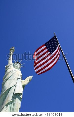 Las Vegas - American flag and Statue of Liberty on the sky - stock photo