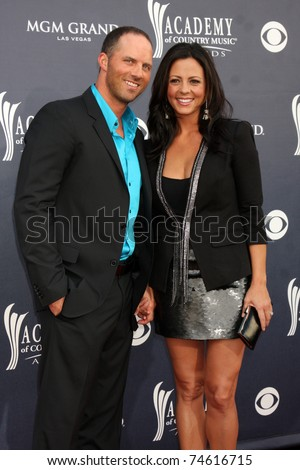 LAS VEGAS - APR 3:  Sara Evans & Husband arriving at the Academy of Country Music Awards 2011 at MGM Grand Garden Arena on April 3, 2011 in Las Vegas, NV. - stock photo