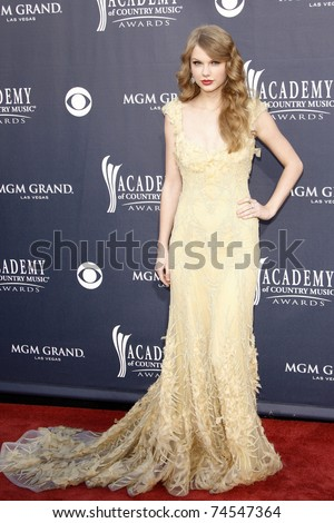 LAS VEGAS - APR 03:  Taylor Swift arriving for the 46th Academy of Country Music Awards at the MGM Grand Hotel Casino in Las Vegas, Nevada on April 3, 2011. - stock photo