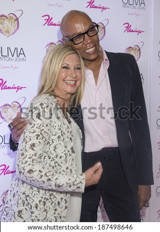 LAS VEGAS - APRIL 11: Entertainer Olivia Newton-John (L) and television personality RuPaul attends the grand opening of her residency show 'Summer Nights' at Flamingo Las Vegas on April 11, 2014  - stock photo