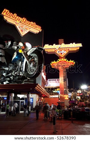 LAS VEGAS - APRIL 09:Harley Davidson Cafe located on the Las Vegas Strip is shown on April 09, 2010 in Las Vegas. The scale replica Sportster, caused traffic to halt when erected in 1997 - stock photo