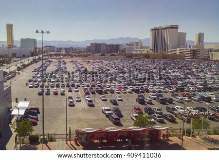 LAS VEGAS - April 2016: Huge parking lot full of cars parked next to Las Vegas Convention Center. - stock photo