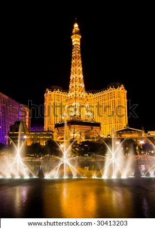 LAS VEGAS - APRIL 1: Musical fountains next to  Eiffel Tower and Hotel Paris on April 1, 2009 in Las Vegas, Nevada. Paris opening date was September 1, 1999. - stock photo