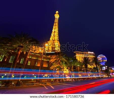 LAS VEGAS - APRIL 17, 2013: the Paris Las Vegas hotel and casino night view in the famous Strip with night lights in Las Vegas, Nevada, April 17, 2013. Featuring a replica of Paris Eiffel Tower - stock photo