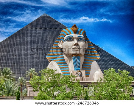 LAS VEGAS - AUG 19: Luxor Las Vegas on August 19, 2009 in Las Vegas. Luxor opened in 1993 and contains a replica of the Great Sphinx of Giza and a pyramid shaped building with a spotlight - stock photo
