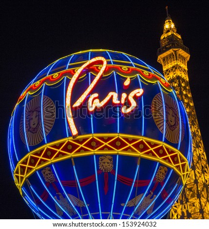 LAS VEGAS - AUG 06 : The Paris Las Vegas hotel and casino on August 06 , 2013 in Las Vegas, Nevada, USA. It includes a half scale, 541-foot (165 m) tall replica of the Eiffel Tower. - stock photo