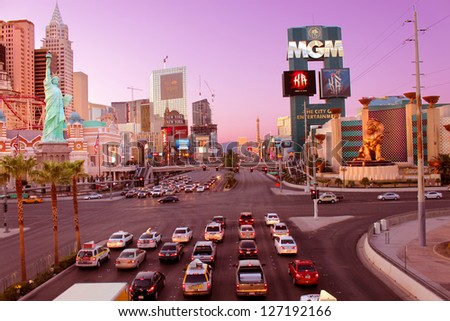 LAS VEGAS - AUGUST 19: Famous Las Vegas Strip on August 19, 2009 in Las Vegas. The Strip is about 4 miles long and seen here are a few of the luxurious hotel casinos that make it famous. - stock photo