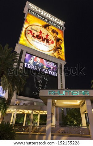 LAS VEGAS - AUGUST 29, 2013 - Mirage sign on August 29, 2013  in Las Vegas. Siegfried & Roy's Secret Garden features a dolphin habitat and a large variety of big cats, including white tigers. - stock photo