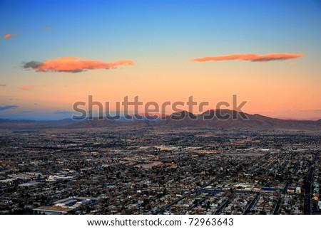 Las Vegas city aerial view panorama sunset with mountain - stock photo