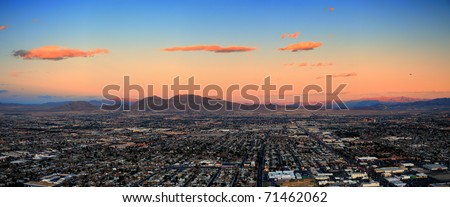 Las Vegas City Skyline panorama with sunset, mountain, luxury hotels and streets. - stock photo
