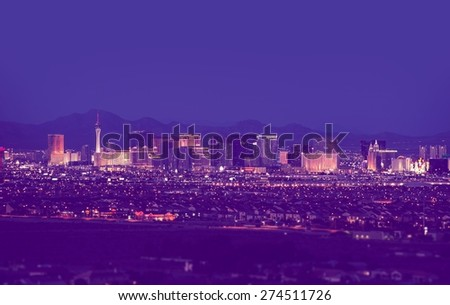 Las Vegas Cityscape at Night in Vintage Purple Color Grading. Las Vegas, Nevada, United States. - stock photo