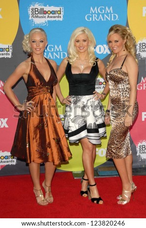 LAS VEGAS - DECEMBER 04: Kendra Wilkinson with Holly Madison and Bridget Marquardt arriving at the 2006 Billboard Music Awards, MGM Grand Hotel December 04, 2006 in Las Vegas, NV