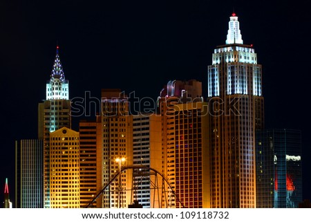 LAS VEGAS - DECEMBER 3: The New York New York Hotel and Casino on December 3, 2011 in Las Vegas. The hotel is on the corner of Tropicana Avenue and Las Vegas Boulevard and seen here from the west. - stock photo