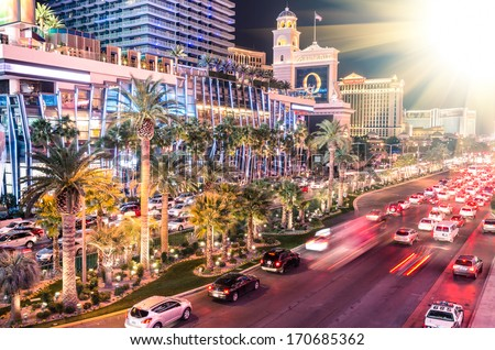 "LAS VEGAS - DECEMBER 7, 2013: traffic jam on Las Vegas Boulevard, simply known as "" Strip "". The Strip was reportedly named by Los Angeles police officer Guy McAfee, after his hometown's Sunset Strip. - stock photo"
