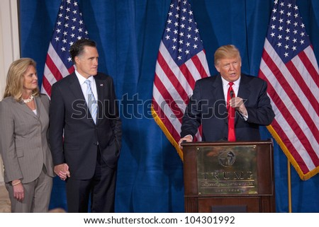 LAS VEGAS - FEB 2: Donald Trump (C) endorses Mitt Romney (2nd-L) for president as he listens with his wife, Ann Romney, at Trump's hotel on February 2, 2012 in Las Vegas, Nevada. - stock photo