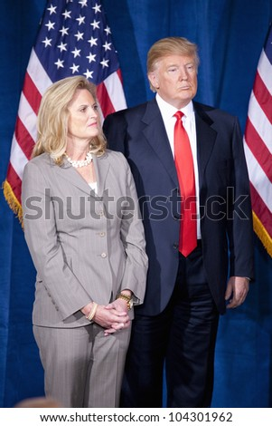 LAS VEGAS - FEB 2: Donald Trump (R) and Ann Romney watch as Mitt Romney speaks at the Trump Hotel on February 2, 2012 in Las Vegas, Nevada. Trump is endorsing Romney for president. - stock photo