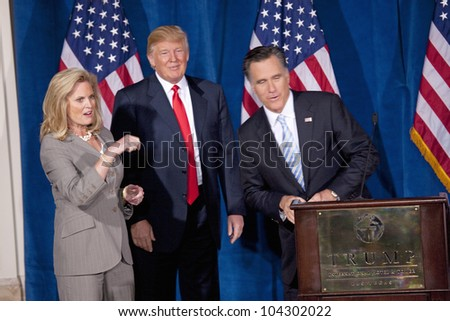 LAS VEGAS - FEB 2: Mitt Romney (R) speaks as Donald Trump and Romney's wife, Ann Romney, listen at the Trump Hotel on February 2, 2012 in Las Vegas, Nevada. Trump is endorsing Romney for president. - stock photo