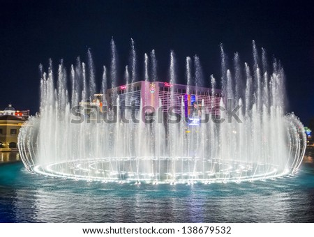 LAS VEGAS - FEB 11: Night view of the dancing fountains of Bellagio and flamingo hotel in Las Vegas Nevada, USA on February 11 , 2013 - stock photo