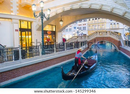 LAS VEGAS - FEB 25 : The Venetian hotel and replica of a Grand canal in Las Vegas on February 25, 2013. With more than 4000 suites it`s one of the most famous hotels in the world - stock photo